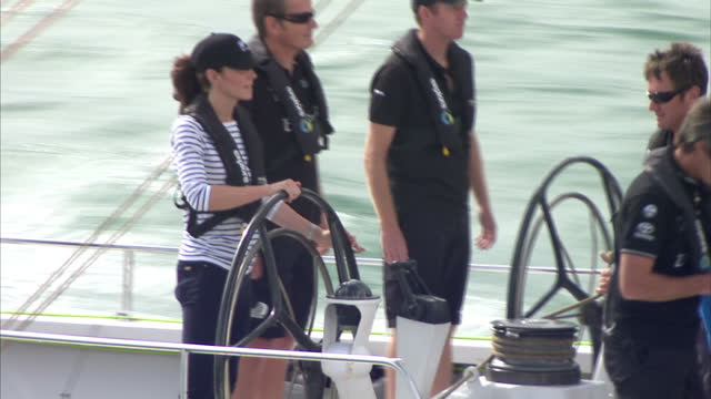 exterior shots of prince william catherine duke duchess of cambridge on yachts in a headtohead harbour race on april 11 2014 in auckland new zealand - helm stock videos & royalty-free footage