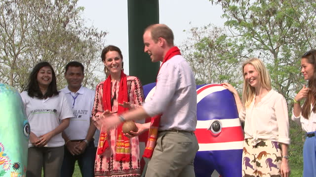Exterior shots of Prince William Catherine Duke Duchess of Cambridge visiting the Mark Shand Fountadion where they paint an elephant parade statue...