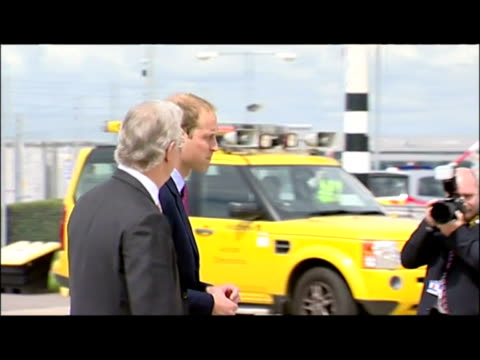 Exterior shots of Prince William Catherine walk across tarmac at Heathrow airport chatting to officials before boarding plane to Canada William Kate...