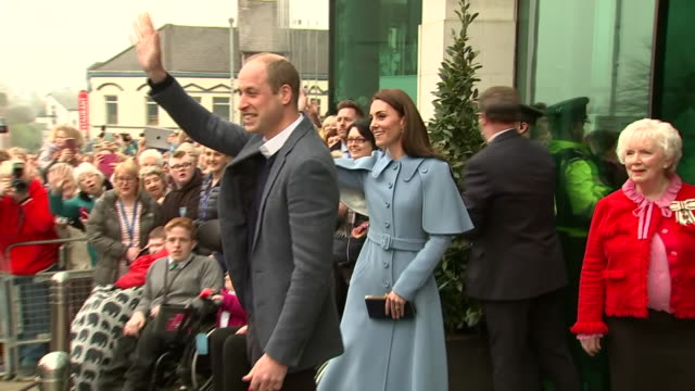 exterior shots of prince william duke of cambridge and catherine duchess of cambridge talking to people before entering the cinemagic at the braid... - duchess of cambridge stock videos and b-roll footage