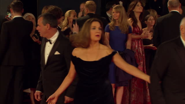 exterior shots of prince william duke of cambridge catherine duchess of cambridge prince harry arriving and meeting barbara broccoli michael g wilson... - spectre 2015 film stock videos and b-roll footage