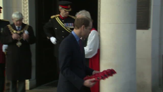 exterior shots of prince william duke of cambridge laying wreath at the unveiling of the victoria cross commemorative paving stones on december 07... - the victoria cross stock-videos und b-roll-filmmaterial