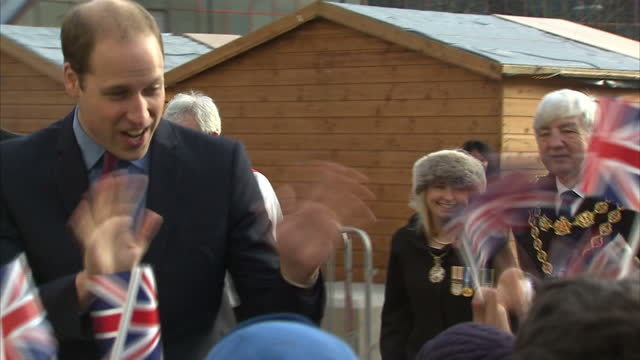 exterior shots of prince william duke of cambridge shaking hands with children in cheering crowd at the unveiling of the victoria cross commemorative... - the victoria cross stock-videos und b-roll-filmmaterial