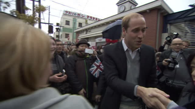 vidéos et rushes de exterior shots of prince william greeting well wishers after departing from tsunami museum on march 01, 2015 in ishinomaki, japan. - museum