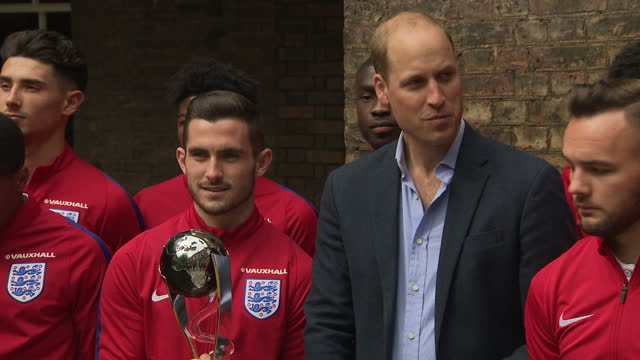 Exterior shots of Prince William posing with members of the England Under20'S football team and management staff during a reception at Kensington...