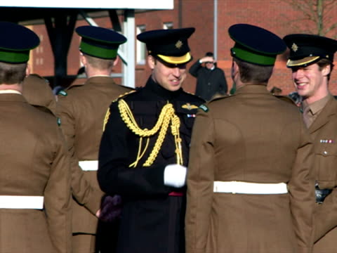 exterior shots of prince william presenting medals to soldiers of the first battalion irish guards at mons barracks for service in operation herrick... - helmand stock videos & royalty-free footage
