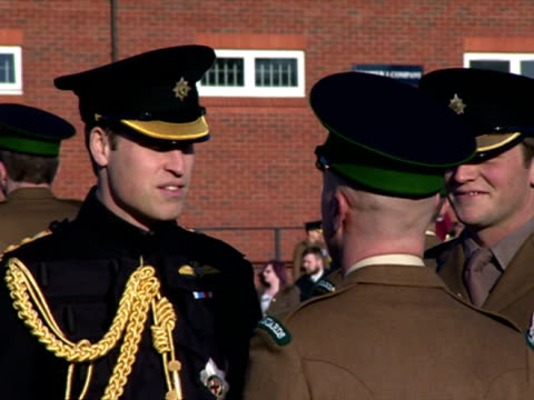 vidéos et rushes de exterior shots of prince william presenting medals to soldiers of the first battalion irish guards at mons barracks for service in operation herrick... - mons barracks