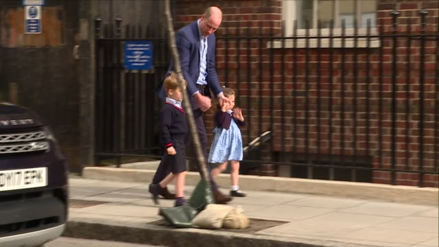exterior shots of prince william walking from a land rover discovery with other children george and charlotte on their first visit to their new baby... - charlotte stock-videos und b-roll-filmmaterial