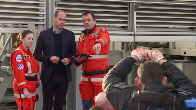 exterior shots of prince william watching a demonstration of london air ambulance paramedics in an exercise demonstrating how they treat stab wound... - visit stock videos & royalty-free footage