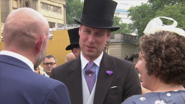 Exterior shots of Prince William wearing a top hat and meeting guests at the Garden Party held at Buckingham Palace on 31st May 2018 in the City of...