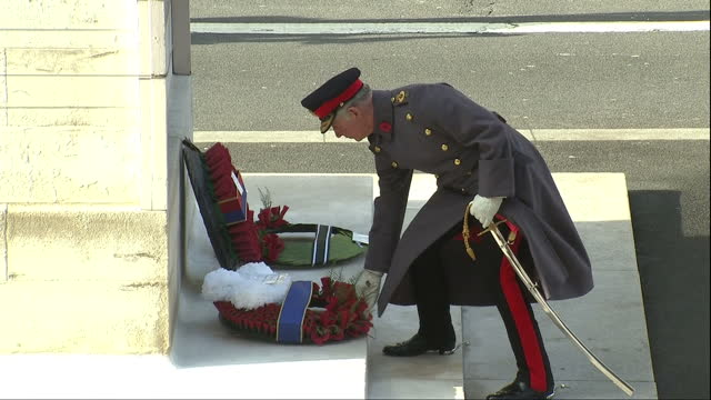 Exterior shots of Princes Charles Harry and William laying wreaths at the Cenotaph during Remembrance Day commemorations on November 13 2016 in...