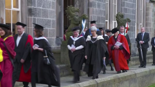 exterior shots of princess anne followed by camilla, the uks duchess of cornwall, at university of aberdeen walking among procession on 14 january... - aberdeen schottland stock-videos und b-roll-filmmaterial