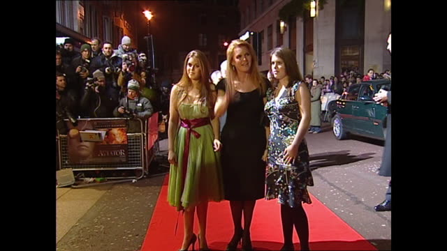 exterior shots of princess beatrice, princess eugenie & sarah ferguson on the red carpet premiere for the aviator on 19th december 2004 in london,... - princess stock videos & royalty-free footage