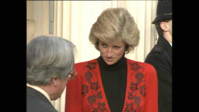 exterior shots of princess diana arriving at and departing from the british red cross society on january 30, 1989 in london, england. - プリンセス点の映像素材/bロール