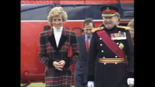 Exterior shots of Princess Diana arriving by The Queens Helicopter Flight dressed in a tartan coat and being greeted by officials on January 23 1989...