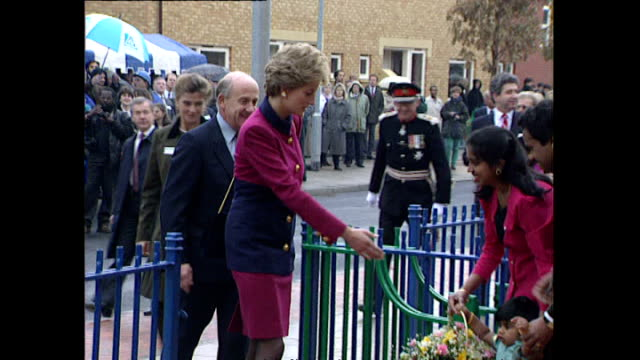 Exterior shots of Princess Diana arriving for a visit opening new homes being presented with flowers on 20 October 1993 in Hulme Manchester
