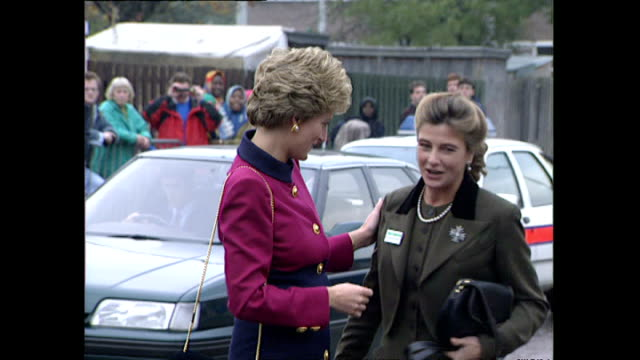 Exterior shots of Princess Diana arriving for a visit opening new homes with crowds cheering and waving Union Jack flags on 20 October 1993 in Hulme...