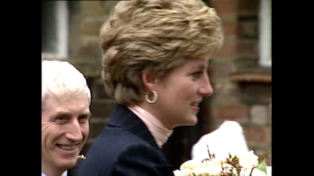 Exterior shots of Princess Diana arriving to visit a YMCA centre in Stockwell meeting local people and officials and receiving a bouquet of flowers...