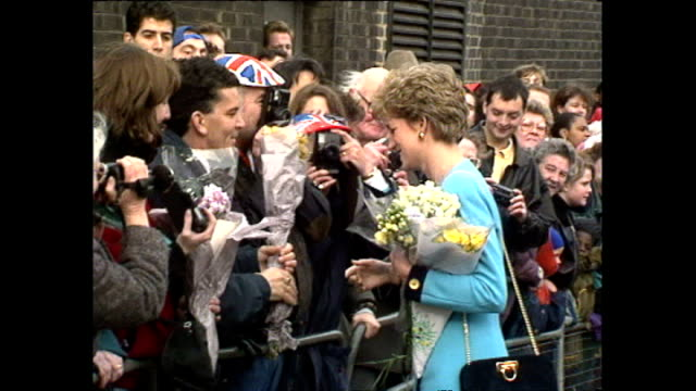 exterior shots of princess diana collecting flowers from members of the public as she departs st matthew's community centre on december 10 1993 in... - collection stock videos & royalty-free footage