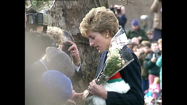 exterior shots of princess diana collecting flowers from members of the public before departing centrepoint charity on december 16 1993 in london... - 1993 stock videos & royalty-free footage