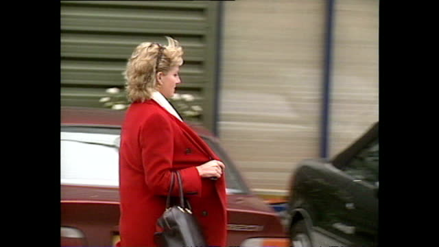exterior shots of princess diana entering and leaving the harbour club health club in a red overcoat in bad weather on 24 january 1996 in london,... - paparazzi photographer stock videos & royalty-free footage