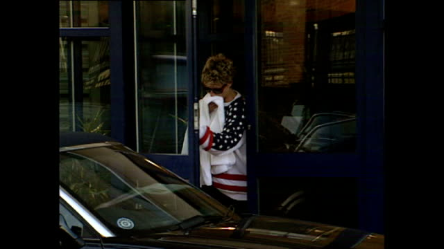 exterior shots of princess diana leaving the gym wearing jumper with american flag and holding a towel. shots of paparazzi peering over fence on... - wearing a towel stock videos & royalty-free footage