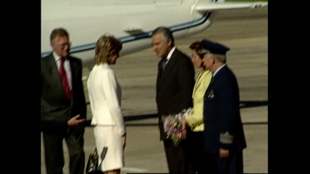 Exterior shots of Princess Diana on arrival in Argentina walking from a helicopter and being greeted by officials and presented with flowers on 23...