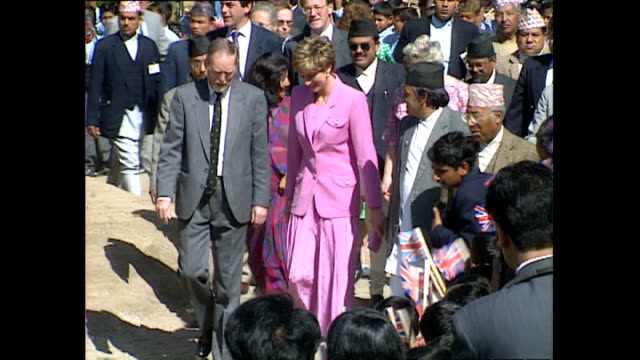 exterior shots of princess diana, princess of wales arriving at hiunchuli school and is greeted by locals and children waving union jack flags and... - nepal stock videos & royalty-free footage