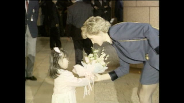 exterior shots of princess diana princess of wales arriving at the red cross headquarters and recieving bouquet from child during royal tour on 8... - 受ける点の映像素材/bロール