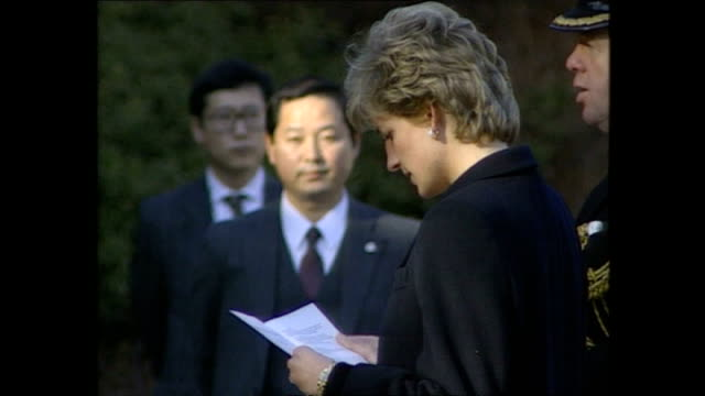 exterior shots of princess diana, princess of wales, being shown round yokohama war cemetery, a commonwealth war cemetery, taking part in memorial... - japan stock videos & royalty-free footage