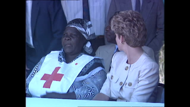 exterior shots of princess diana, princess of wales, chatting with a red cross employee at a red cross water station during her royal tour on 12 july... - conceptual symbol stock videos & royalty-free footage