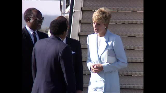 exterior shots of princess diana, princess of wales departing british airways plane and greeted by offficials for start of royal tour on 10 july... - conceptual symbol stock videos & royalty-free footage
