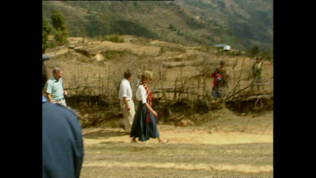 stockvideo's en b-roll-footage met exterior shots of princess diana princess of wales getting onto helicopter after visiting majhuwa village wearing flower garlands during her royal... - guirlande