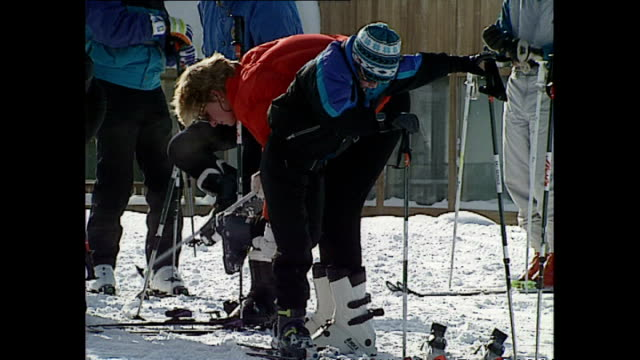 exterior shots of princess diana, princess of wales, helping prince harry put on his ski's whilst on skiing holiday on 28 march 1993 lech, austria. - ski holiday stock videos & royalty-free footage