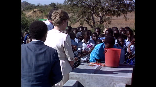 exterior shots of princess diana princess of wales inspecting water pump at a red cross water station during her royal tour on 12 july 1993... - rotes kreuz organisierte gruppe stock-videos und b-roll-filmmaterial