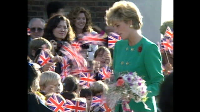 exterior shots of princess diana, princess of wales, leaving building after being shown round british school with street lined with children waving... - 1992 stock videos & royalty-free footage