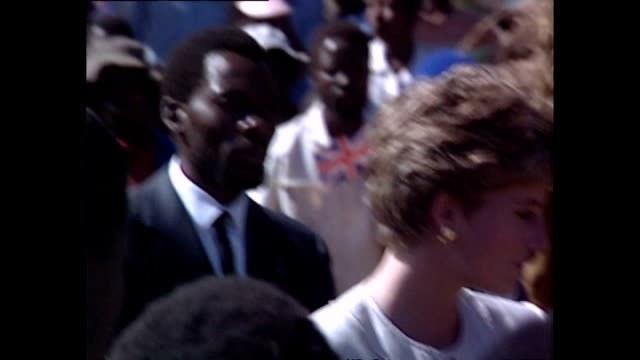 exterior shots of princess diana, princess of wales, listening to speech as she visits school during her royal tour on 12 july 1993, harare, zimbabwe. - conceptual symbol stock videos & royalty-free footage