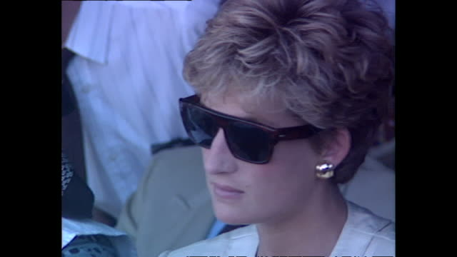 exterior shots of princess diana princess of wales sitting down watching a live performance from dancers as she puts on her sunglasses at a red cross... - rotes kreuz organisierte gruppe stock-videos und b-roll-filmmaterial