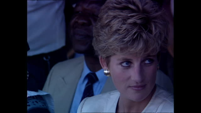 exterior shots of princess diana princess of wales sitting down watching a live performance from dancers at a red cross water station during her... - rotes kreuz organisierte gruppe stock-videos und b-roll-filmmaterial