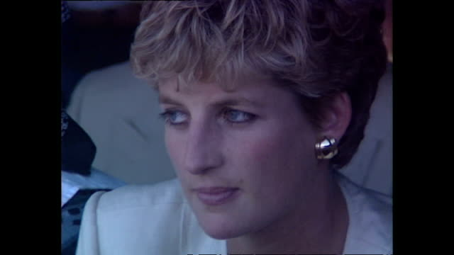 exterior shots of princess diana princess of wales sitting down watching live performance form dancers during visit to a red cross water station... - rotes kreuz organisierte gruppe stock-videos und b-roll-filmmaterial