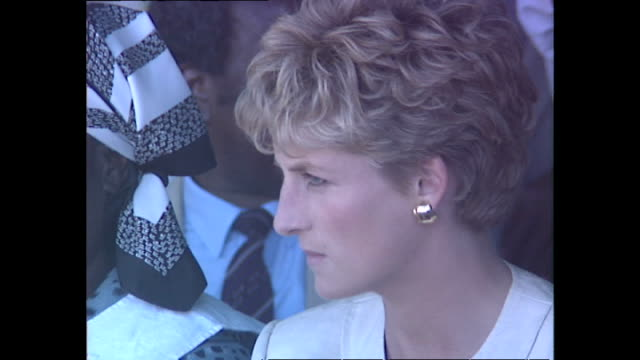 exterior shots of princess diana princess of wales sitting down during visit to a red cross water station during her royal tour on 12 july 1993... - rotes kreuz organisierte gruppe stock-videos und b-roll-filmmaterial