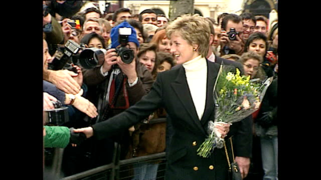 exterior shots of princess diana princess of wales visiting centrepoint homeless shelter and recieving flowers from members of the public outside on... - homeless shelter stock videos & royalty-free footage