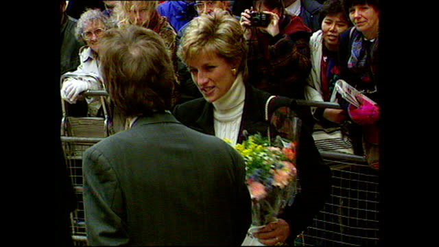 exterior shots of princess diana princess of wales visiting centrepoint homeless shelter and receiving flowers from members of the public outside... - homeless shelter stock videos and b-roll footage