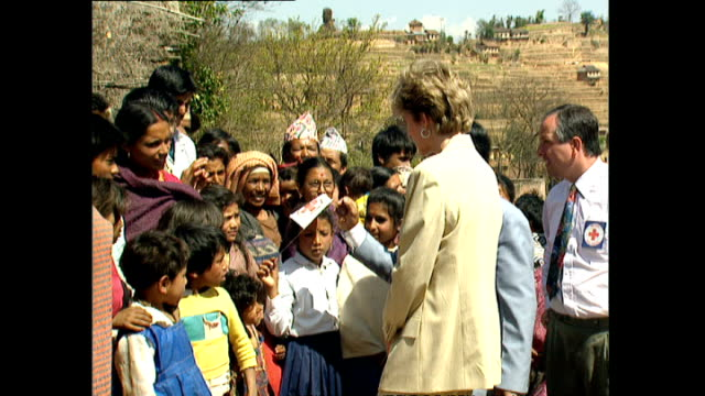 exterior shots of princess diana, princess of wales visiting panauti red cross project and meeting children and locals gathered outside during her... - conceptual symbol stock videos & royalty-free footage