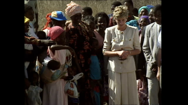 exterior shots of princess diana princess of wales visiting red cross feeding station meeting locals during her royal visit on 10 july 1993... - ロイヤルツアー点の映像素材/bロール