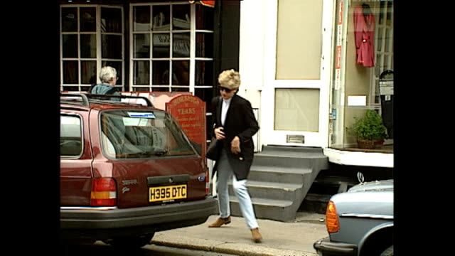 Exterior shots of Princess Diana Princess of Wales walking down street in Knightsbridge and jumps into car to avoid paparazzi on 18 May 1994 London...