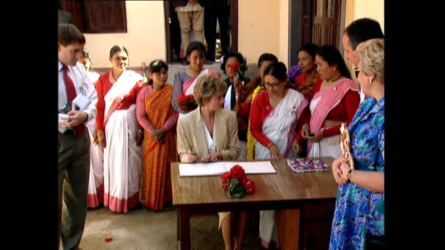 exterior shots of princess diana princess of wales walking round panauti red cross project and signing book before getting into car during her royal... - red cross stock videos & royalty-free footage