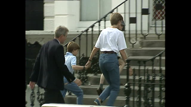 exterior shots of princess diana taking prince harry to wetherby school with prince william she gives the press an annoyed look as she leaves on 8... - 1992 stock videos and b-roll footage