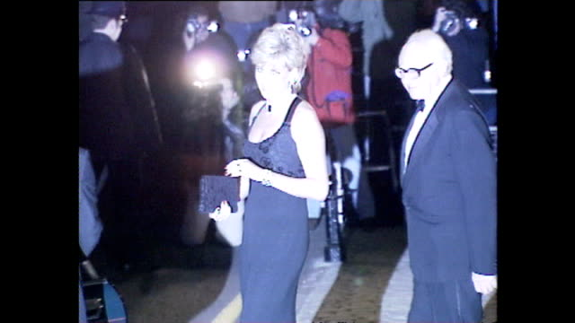 exterior shots of princess diana walking from a building to a waiting car after a gala dinner on 20 november 1995 in london, united kingdom - paparazzi photographer stock videos & royalty-free footage