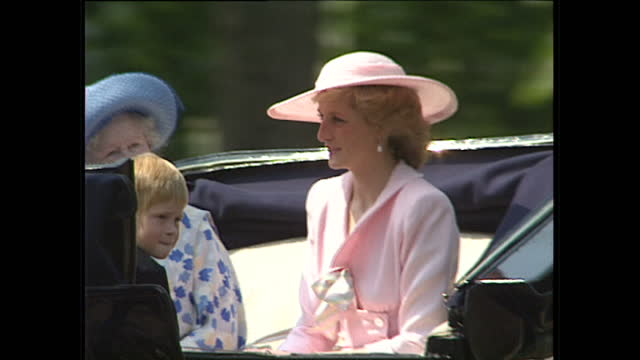 exterior shots of princess diana wearing a pink suit and hat sat with the queen mother prince william prince harry waving to crowds from an open top... - trooping the colour stock videos & royalty-free footage
